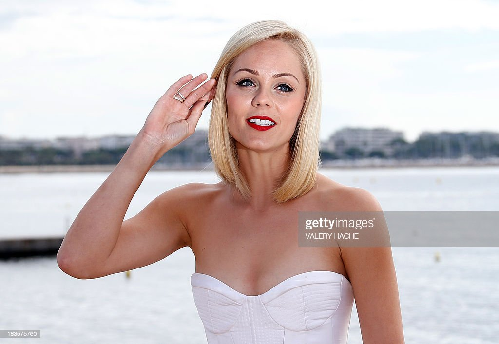 Canadian actress Laura Vandervoort poses during a photocall for a TV show 'Bitten' as part of the Mipcom international audiovisual trade show at the Palais des Festivals, in Cannes, southeastern France, on October 7, 2013.