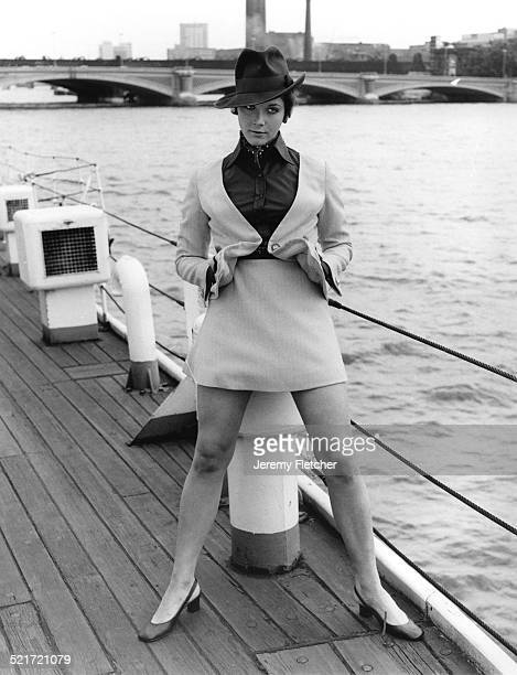 Canadian actress Linda Thorson on a boat moored on the River Thames in London during a publicity photoshoot for the television series 'The Avengers'...