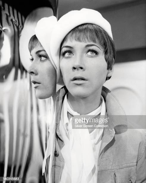 Canadian actress Linda Thorson posing by a mirror as Tara King in a promotional portrait for the british TV series 'The Avengers' circa 1968