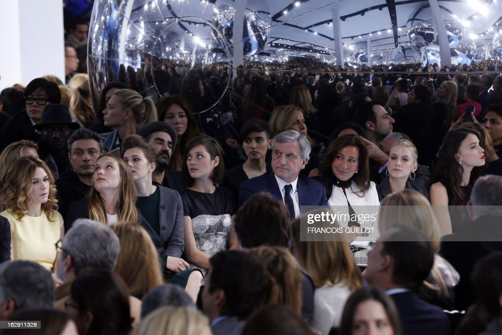 Canadian actress Marie-Josee Croze, French actress Ana Girardot, French actress Marion Cotillard , CEO of Christian Dior Couture Sidney Toledano and wife Katia, French actress Melanie Laurent, Chelsea Anna Tallarico, daughter of US singer Steven Tyler and US actor Jon Foster attend the Christian Dior's Fall/Winter 2013-2014 ready-to-wear collection show, on March 1, 2013 in Paris. AFP PHOTO/FRANCOIS GUILLOT
