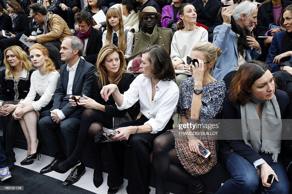 Canadian actress Marie-Josee Croze, US actress Jessica Chastain, guests, Ukrainian-born actress Milla Jovovich and model Laura Bailey attend on March 5, 2013 Chanel's Fall/Winter 2013-2014 ready-to-wear collection show at the Grand Palais in Paris.