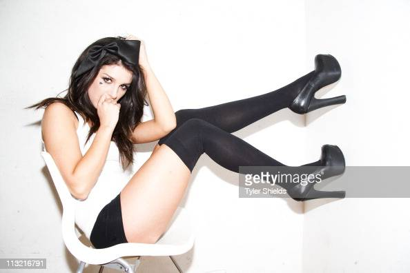 Canadian actress Shenae Grimes is photographed for for her charity Spread The Heart by photographer Tyler Shields on April 21 2011 in Los Angeles...