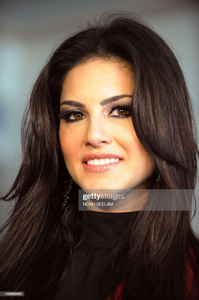 Canadian actress Sunny Leone smiles during a promotional event in Hyderabad on August 7, 2012 The Indian/ Canadian porn star Leone made her Bollywood debut in her new movie Jism-2 which is expected to be one of India's raunchiest mainstream movies, which is already raising eyebrows in the sexually conservative country. AFP PHOTO / Noah SEELAM