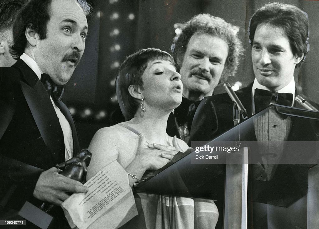 AWARDS - APRIL 14, 1979 - Canadian Air farce receive their ACTRA for Best Radio Variety Performance. From left, Roger Abbott, Luba Goy, Dave Broadfoot, and Don Ferguson.