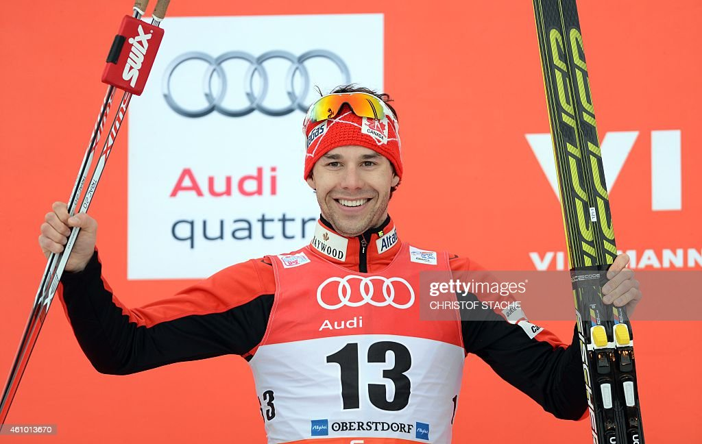 Canadian <a gi-track='captionPersonalityLinkClicked' href=/galleries/search?phrase=Alex+Harvey+-+Skier&family=editorial&specificpeople=6719953 ng-click='$event.stopPropagation()'>Alex Harvey</a> celebrates the winner ceremony after the men's 15 kilometers pursuit classic style competition of the 'Tour de Ski' Cross Country World Cup on January 4, 2015 in Oberstdorf, southern Germany. Norway's Petter Jr Northug won the competition, Canadian <a gi-track='captionPersonalityLinkClicked' href=/galleries/search?phrase=Alex+Harvey+-+Skier&family=editorial&specificpeople=6719953 ng-click='$event.stopPropagation()'>Alex Harvey</a> placed second and Swedish Calle Halfvarsson placed third.
