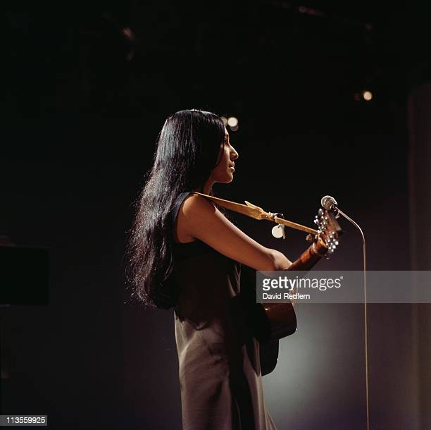 Buffy SainteMarie Cree singersongwriter playing guitar during a live concert performance circa 1975