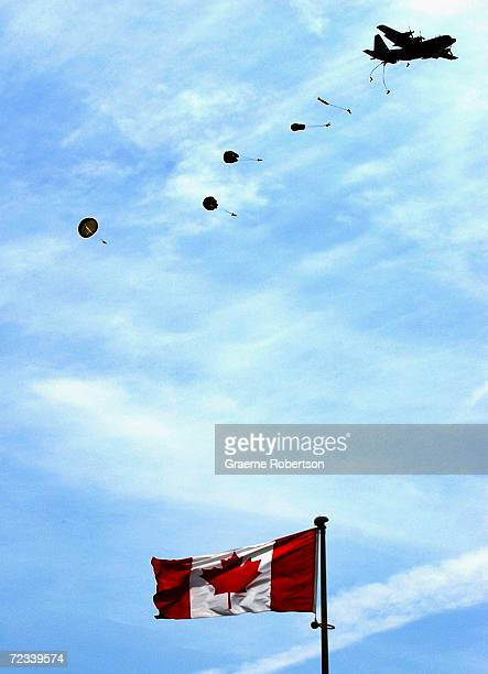 Canadian Army soldiers parachute into the Canadian War Cemetery on June 6 2003 near Juno Beach at BenysurMer/Reviers Normandy Northern France The...