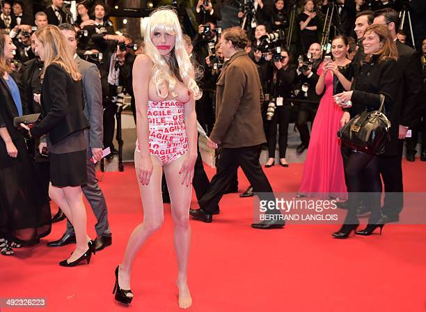Canadian artist Zoe Duchesne performs on the red carpet as guest arrive for the screening of the film 'Maps to the Stars' at the 67th edition of the...