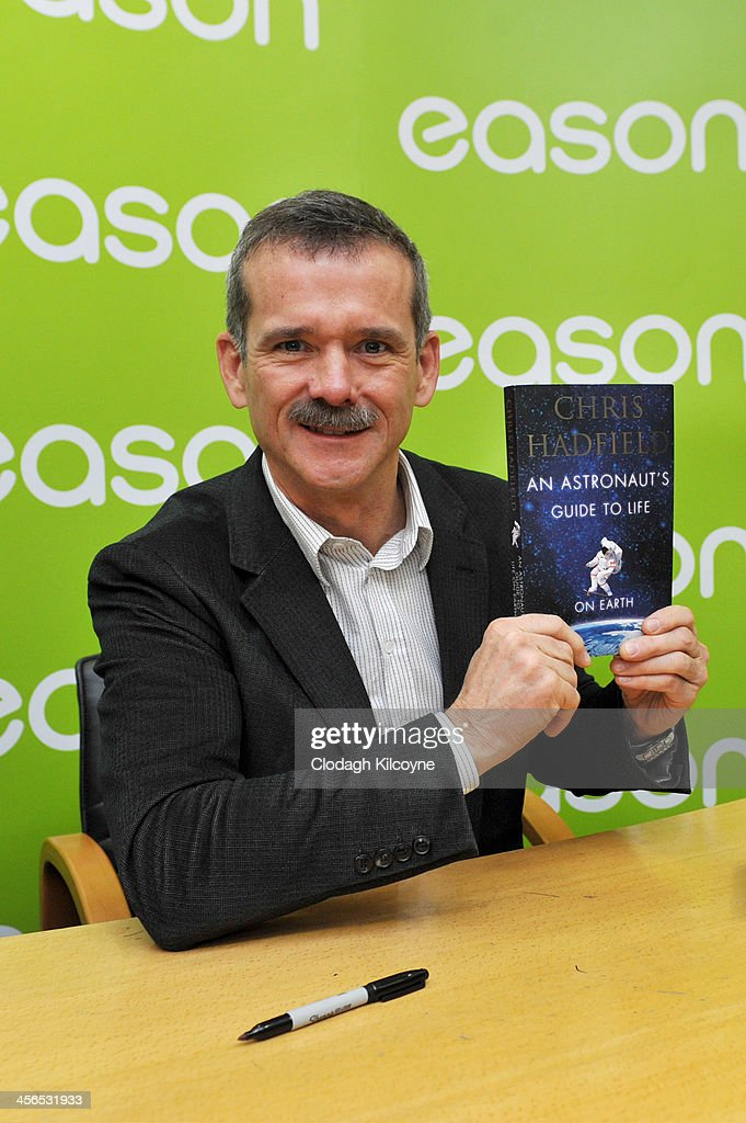 Canadian astronaut <a gi-track='captionPersonalityLinkClicked' href=/galleries/search?phrase=Chris+Hadfield&family=editorial&specificpeople=2700911 ng-click='$event.stopPropagation()'>Chris Hadfield</a> attends a book signing for his book 'An Astronaut's Guide to Life on Earth' in Eason book shop on O'Connell Street on December 14, 2013 in Dublin, Ireland.