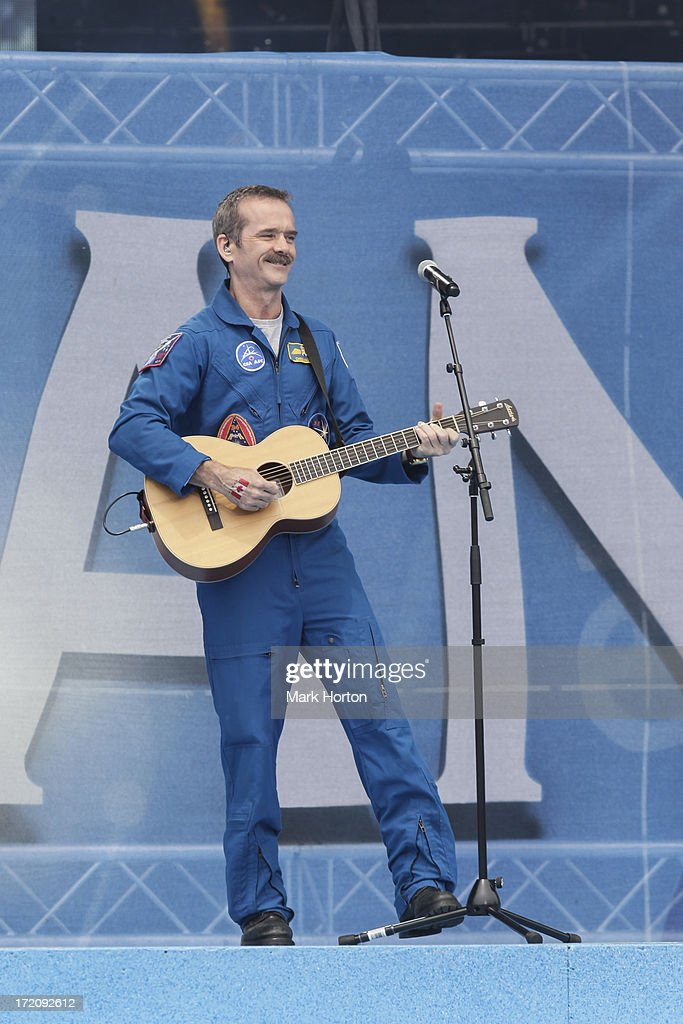 Canadian astronaut <a gi-track='captionPersonalityLinkClicked' href=/galleries/search?phrase=Chris+Hadfield&family=editorial&specificpeople=2700911 ng-click='$event.stopPropagation()'>Chris Hadfield</a> performs during Canada Day celebrations on Parliament Hill on July 1, 2013 in Ottawa, Canada.