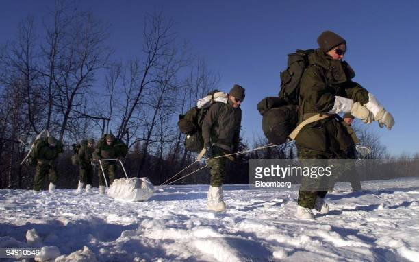 Canadian Astronaut Julie Payette leads a line of astronauts as they train in Valcartier Quebec Canada on Wednesday January 21 2004 The strenuous...