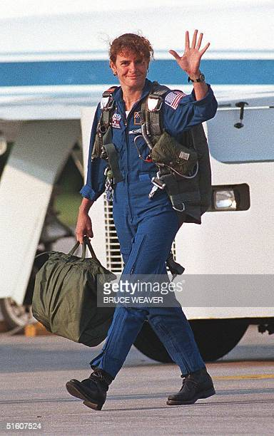Canadian Astronaut Julie Payette waves to the media 25 May 1999 at Kennedy Space Center's Shuttle Landing Facility after a morning flight in a NASA...