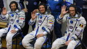 Canadian astronaut Robert Thirsk European Space Agency astronaut Frank De Winne of Belgium and Russian cosmonaut Roman Romanenko wave after putting...