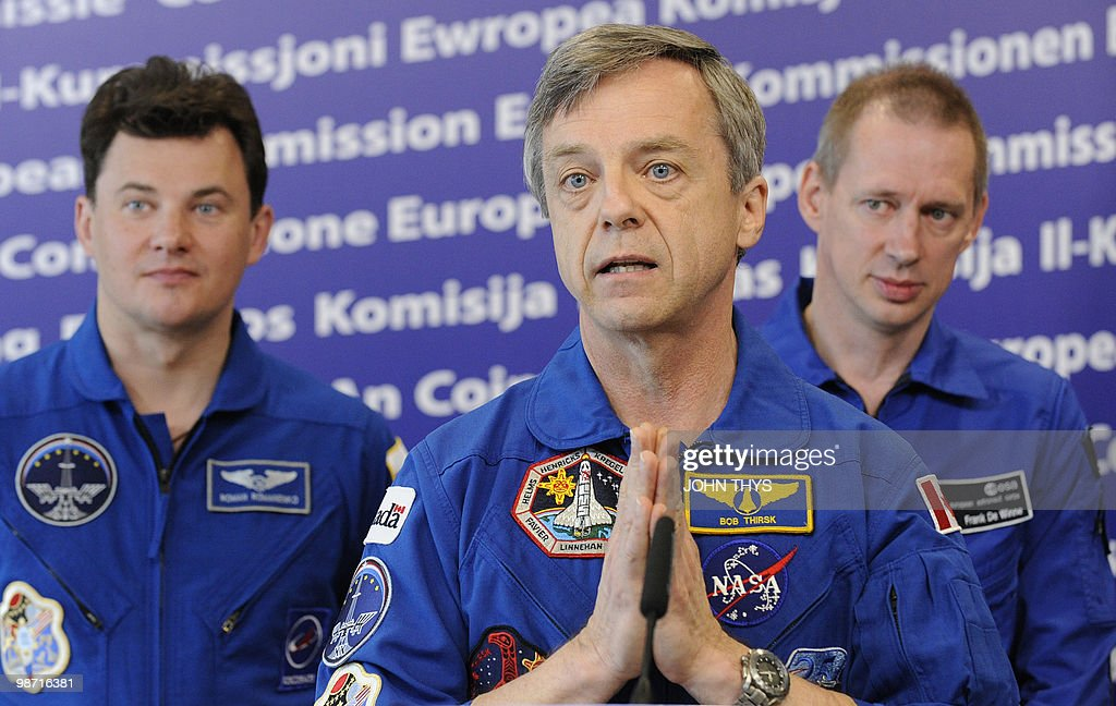 Canadian Astronaut Robert Thirsk (C) speaks during the after the joint press with Belgian Astronaut of the European Space Agency (ESA) Frank De Winne (R), Russian Cosmonaut Roman Romanenko (L) at the EU headquarters in Brussels on April 28, 2010.