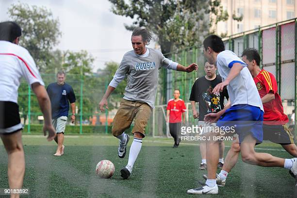 Canadian basketball star Steve Nash plays a pickup game of soccer at the Dongdan courts in central Beijing on August 30 2009 Nash a twotime NBA most...