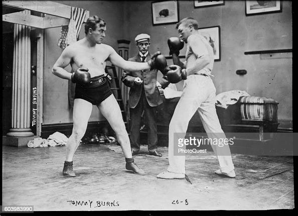 Canadian boxer Tommy Burns spars with an unidentified opponant circa 1908