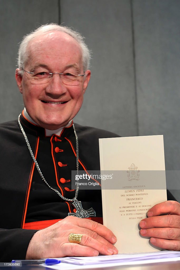 Canadian Cardinal <a gi-track='captionPersonalityLinkClicked' href=/galleries/search?phrase=Marc+Ouellet&family=editorial&specificpeople=3145328 ng-click='$event.stopPropagation()'>Marc Ouellet</a>, prefect of the Congregation for the Doctrine of the Faith holds a copy of Pope Francis' first encyclical, entitled 'Lumen Fidei' (The Light of Faith) during a press conference at the the Holy See Press Office on July 5, 2013 in Vatican City, Vatican. The document continues many of Benedict's favourite themes, from the complementarity of faith and reason, to the joy of a personal encounter with Christ. Firmly situated in the Year of Faith, it's also set in the context of the 50th anniversary of the Second Vatican Council, which re-established the central role of Faith at the heart of all human relationships.