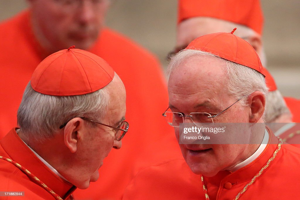 Canadian Cardinal Mark Ouellet (R) chats with a collegue during the mass and imposition of the Pallium upon the new metropolitan archbishops held by Pope Francis for the Solemnity of Saint Peter and Paul at Vatican Basilica on June 29, 2013 in Vatican City, Vatican. Pope Francis delivered the homily at Mass in St Peter's Basilica on Saturday morning, to mark the Solemnity of Saints Peter and Paul, Apostles and Patrons fo the city of Rome. In his remarks following the Gospel reading, the Holy Father focused on a particular task of the Petrine ministry, which is to strengthen, or confirm, all the faithful.
