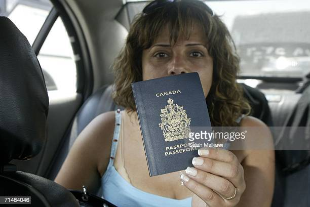 Canadian citizen shows her passport as arrives at the LebaneseSyrian border on July 19 2006 at Masnaa Lebanon Two Israeli soldiers and one Hezbollah...