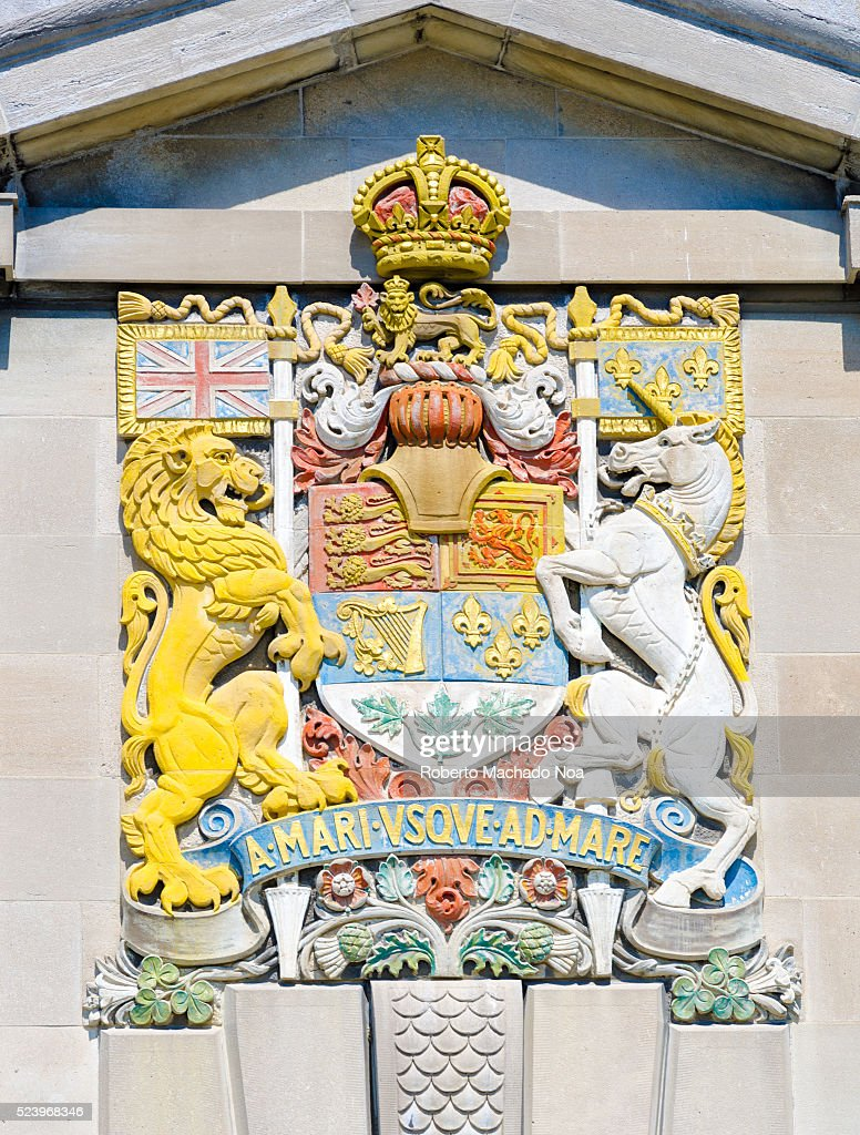 canadian coat of arms engraved in colorful stone wall pictures