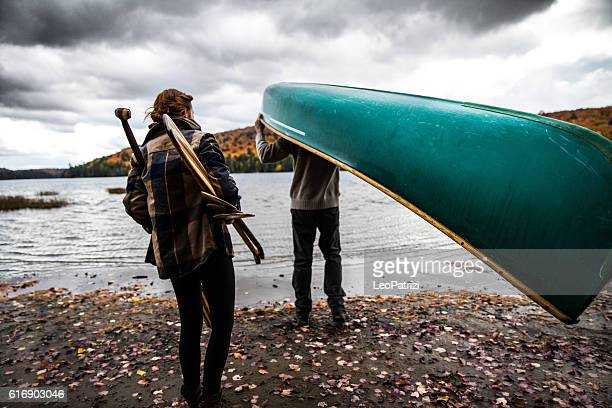 Canadian couple spending holidays together canoeing at park
