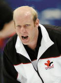Canadian curly skip Kevin Martin directs his teammates in their match against Denmark during the men's curling event 18 February 2002 at the Salt...