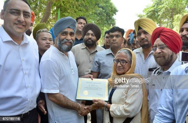 Canadian Defence Minister Harjit Singh Sajjan being honoured by Bibi Inderjit Kaur Patron President of All India Pingalwara Charitable Society at...