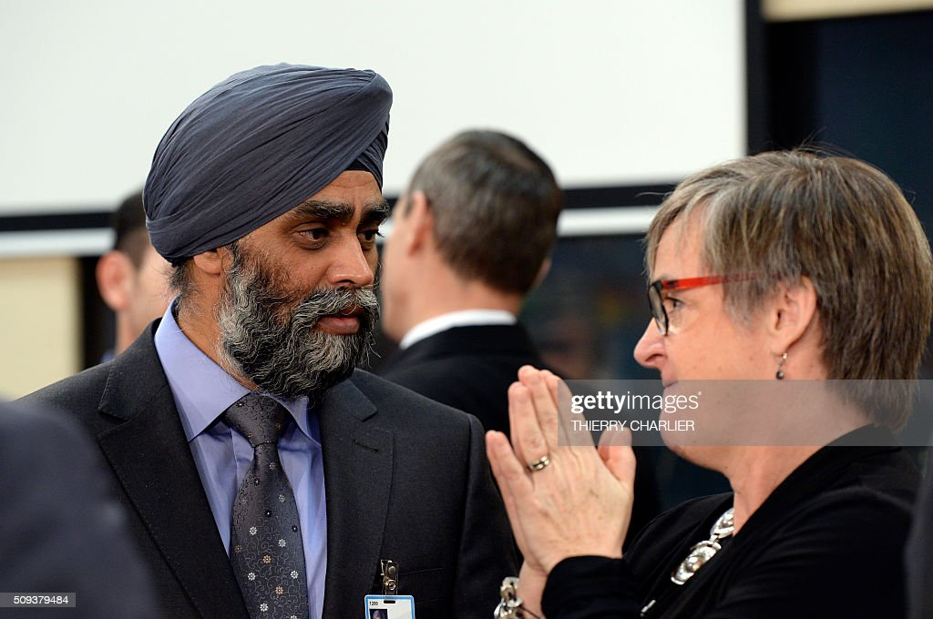 Canadian Defence Minister Harjit Singh Sajjan looks on before the North Atlantic Council (NAC) of Defence Ministers at NATO headquarter in Brussels on February 10, 2016. NATO defence ministers convene a two-day meeting to discuss current defense issues and whether the Alliance should take a more direct role in dealing with its gravest migrant crisis since Worl War II. / AFP / THIERRY CHARLIER
