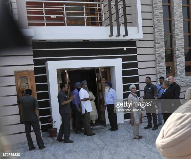 Canadian Defence Minister Harjit Singh Sajjan with his father and mother at their house in ancestral village Bombeli on April 20 2017 in Hoshiarpur...