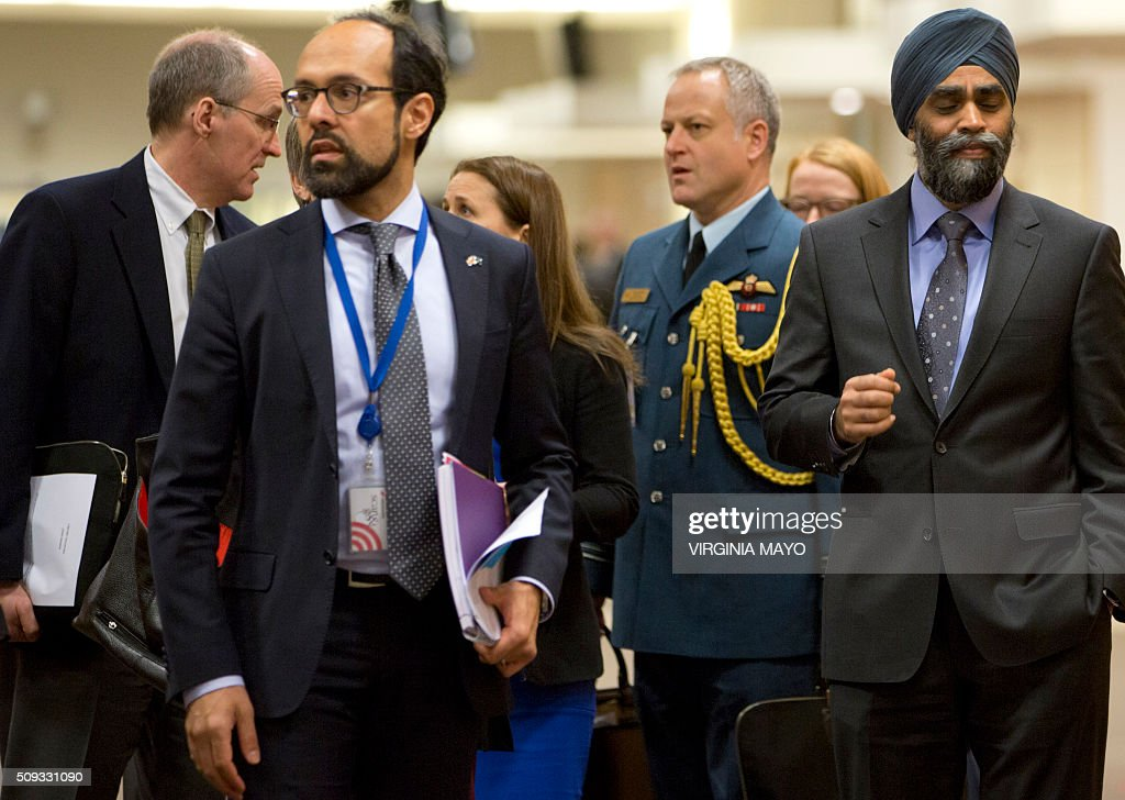 Canadian Defense Minister Harjit Singh Sajjan (R) arrives for a meeting at NATO headquarters in Brussels on February 10, 2016. NATO defense ministers convene a two-day meeting to discuss current defence issues and whether the Alliance should take a more direct role in dealing with its gravest migrant crisis since WWII. / AFP / POOL / Virginia Mayo