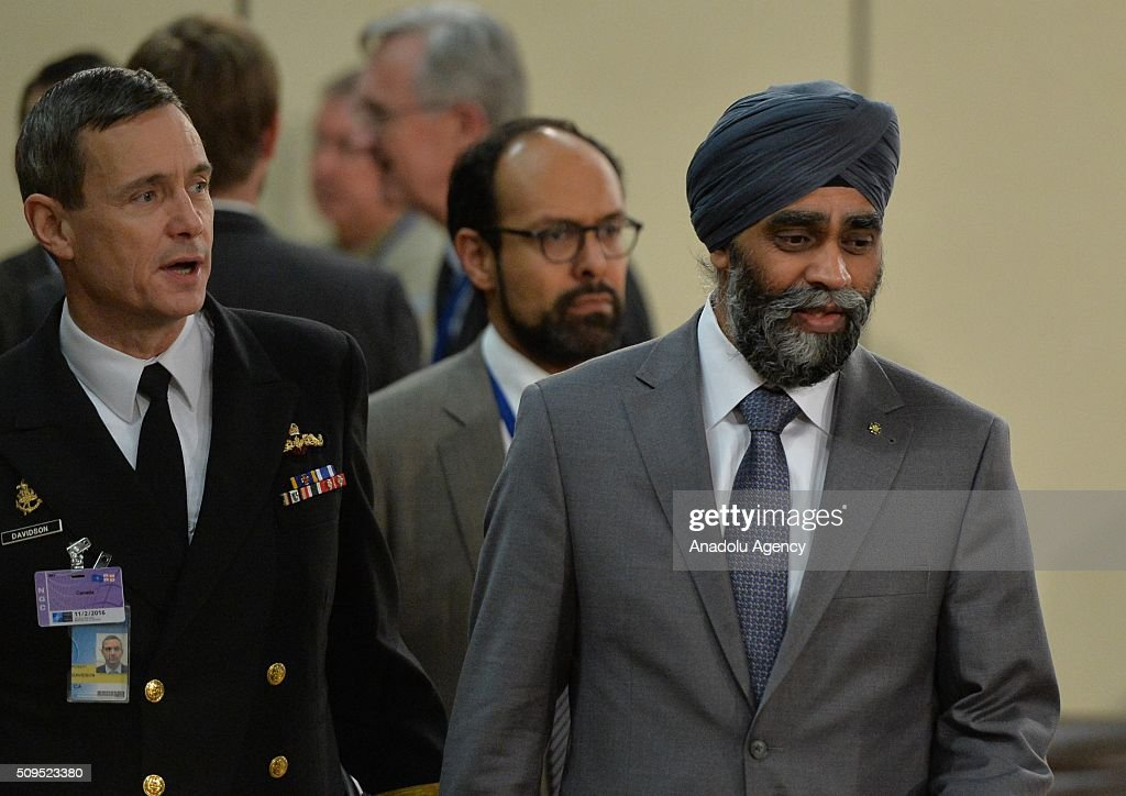 Canadian Defense Minister Harjit Singh Sajjan (R) attends the NATO Defence Ministers Meeting which is being held in Brussels, Belgium on February 11, 2016.