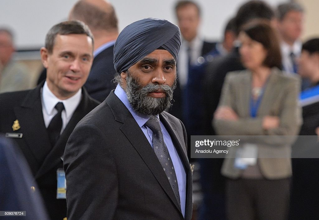 Canadian Defense Minister Harjit Singh Sajjan (R) is seen prior to the start of a NATO Defence Ministers meeting at the NATO headquarter in Brussels, Belgium on February 10, 2016.
