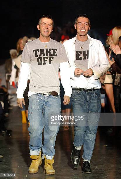 Canadian designers Dean and Dan Caten acknowledge the applause at the end of their DSQUARED2 Autumn/Winter women's collection 2004/2005 on February...