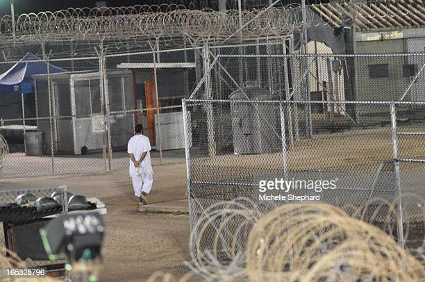 BAY 11/04/09 Canadian detainee Omar Khadr walks the grounds of Camp 4 in Guantanamo Bay praying before dawn in this Nov 4 2009 photo cleared for...
