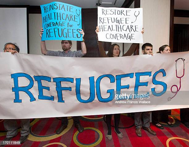 Canadian Doctors for Refugee Care raise a banner during a speech by Danielle Grondin MD FRCPC Director General Citizenship Immigration Canada Action...