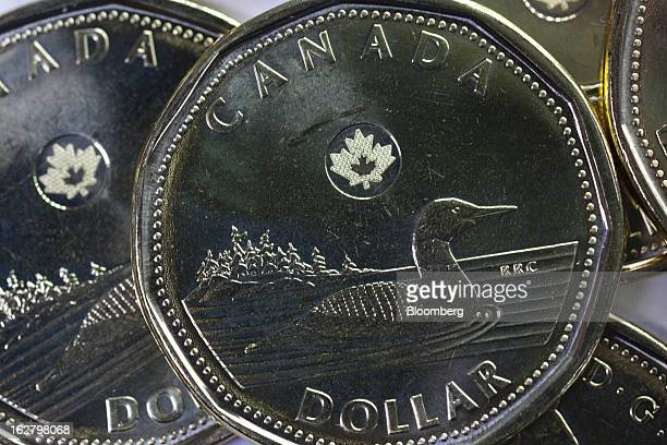 Canadian dollar coins known as a 'Loonies' are arranged for a photograph in Toronto Ontario Canada on Tuesday Feb 26 2013 Canada's dollar traded at...