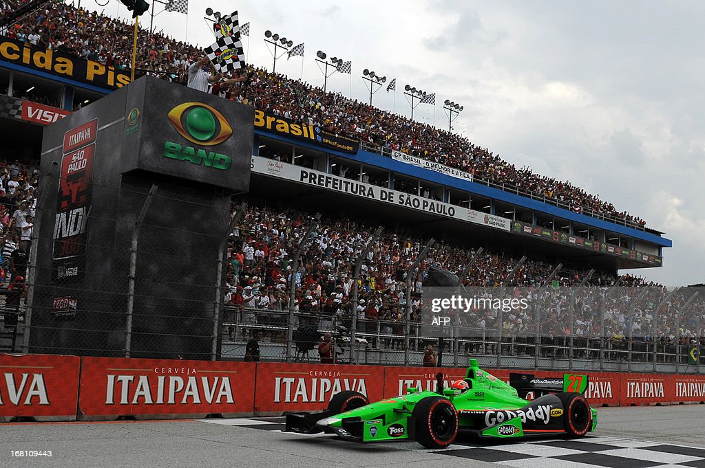 Canadian driver James Hinchcliffe of Andretti Autosport team, crosses the finish line to win the Sao Paulo Indy 300 at Sambadrome racetrack in Sao Paulo, Brazil, on May 5, 2013. Hinchcliffe won ahead of US Marco Andretti of Andretti Autosport and Japan's Takuma Sato of AJ Foyt Racing. AFP PHOTO/Nelson ALMEIDA