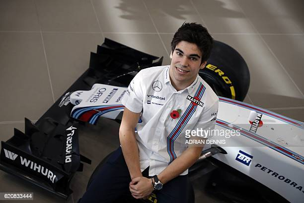 Canadian driver Lance Stroll poses for a photograph following the announcement by Williams Martini Racing of their driver line up for the 2017 FIA...
