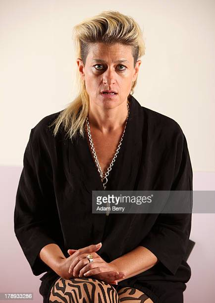 Canadian electronic musician and performance artist Peaches poses while sitting in the 'live exhibit' portion of the exhibition 'The Whole Truth...