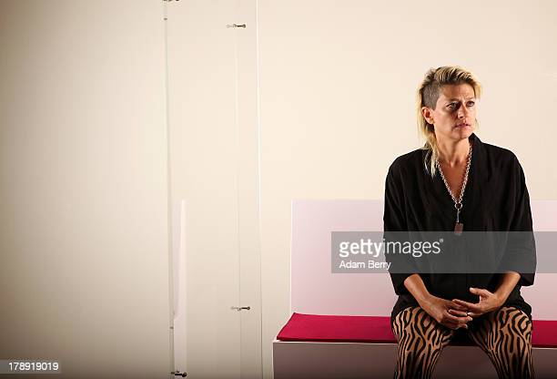 Canadian electronic musician and performance artist Peaches sits in the 'live exhibit' portion of the exhibition 'The Whole Truth Everything You...
