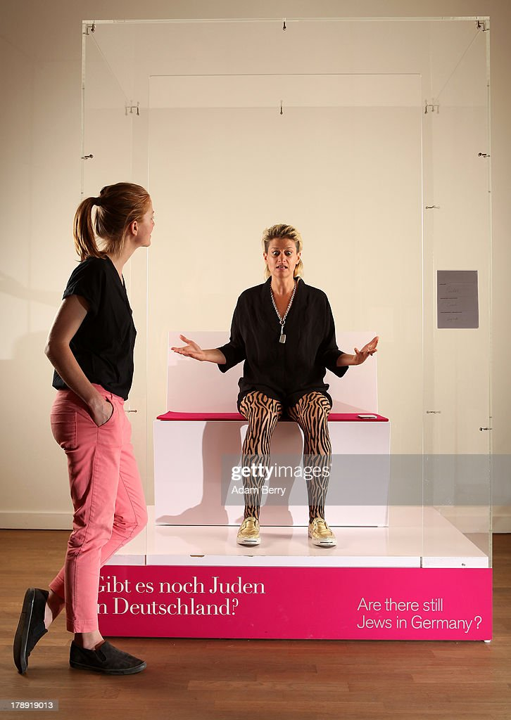 Canadian electronic musician and performance artist Peaches (Merrill Beth Nisker) (R) speaks with visitor Kati Krause in the 'live exhibit' portion of the exhibition 'The Whole Truth - Everything You Always Wanted To Know About Jews...' on its second to last day after a run of over five months at the Juedisches Museum (Jewish Museum Berlin) on August 31, 2013 in Berlin, Germany. The temporary exhibition, which challenges cliches about Jews, featured a different volunteer 'real live Jew' on site for two hours every day to answer visitors' spontaneous questions about their religion. Critics compared the exhibit to 19th-century European freak show attractions, but supporters see the live section as being educational for visitors.