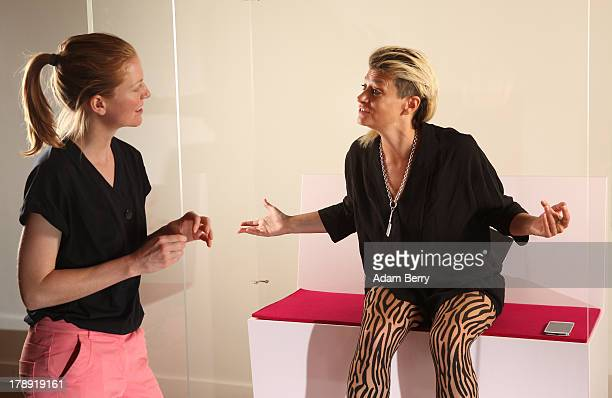 Canadian electronic musician and performance artist Peaches speaks with visitor Kati Krause in the 'live exhibit' portion of the exhibition 'The...