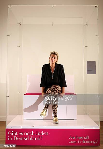 Canadian electronic musician and performance artist Peaches waits for visitors in the 'live exhibit' portion of the exhibition 'The Whole Truth...
