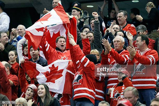 Canadian fans celebrate in the stands during the game against Team Canada and Team Czech Republic at the IIHF World Junior Championships at...