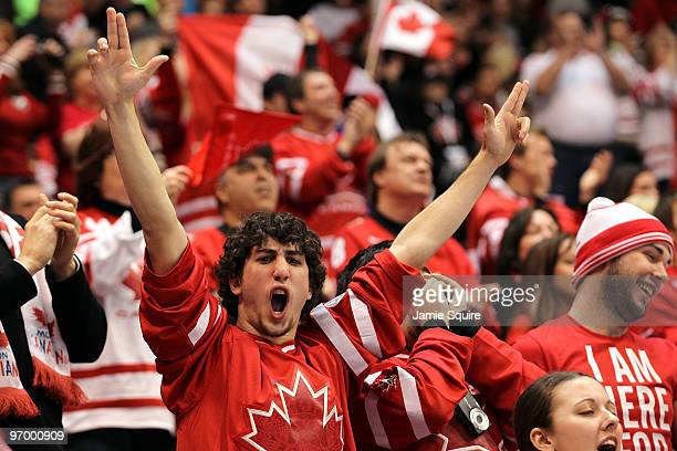 Canadian fans cheer during the ice hockey Men's Qualification Playoff game between Germany and Canada on day 12 of the Vancouver 2010 Winter Olympics...