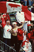 Canadian fans cheer on their ice hockey team during the final game at the 1998 Winter Olympic games