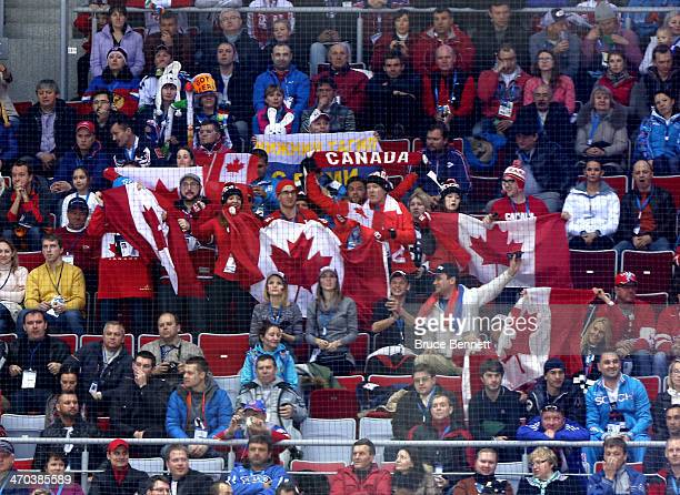 Canadian fans hold up flags and scarves during the Men's Ice Hockey Quarterfinal Playoff against Latvia on Day 12 of the 2014 Sochi Winter Olympics...
