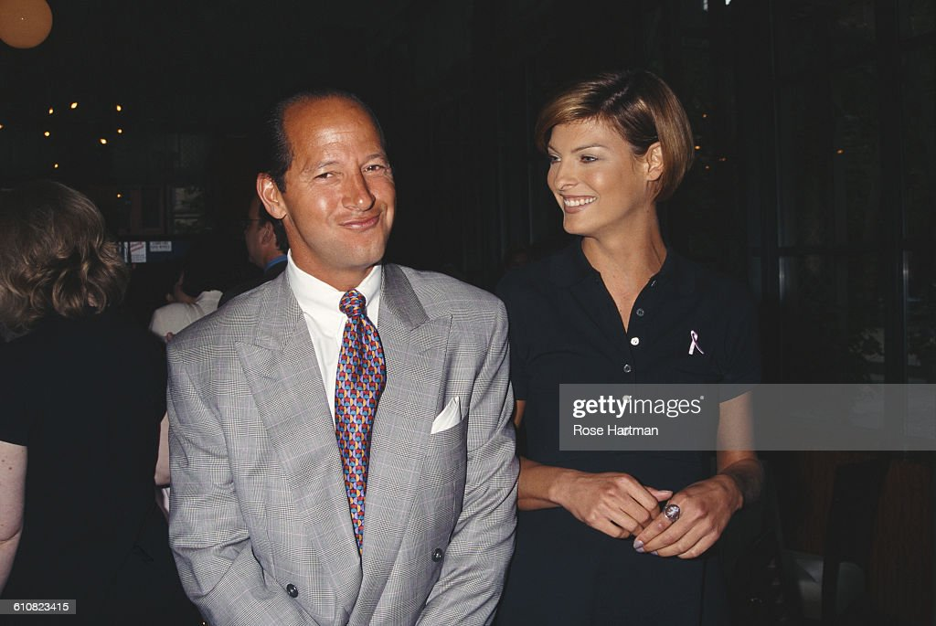 Canadian fashion model Linda Evangelista and American magazine executive Ron Galotti at a breast cancer awareness benefit, New York City, 1996.