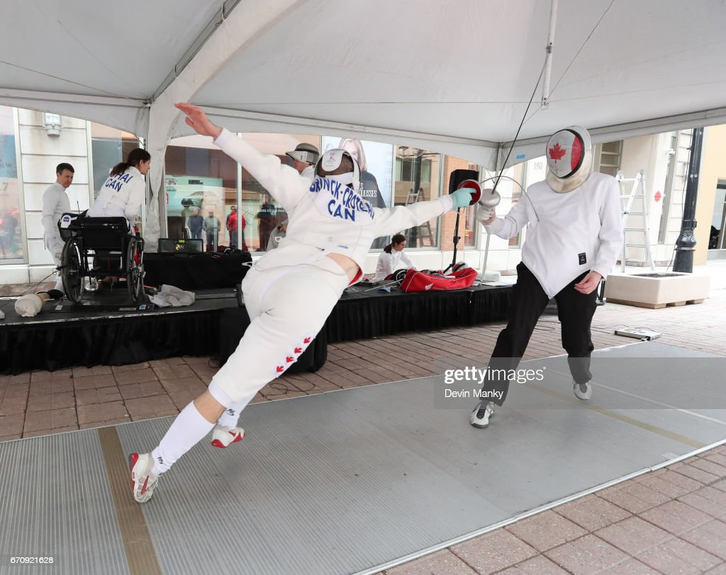 Canadian Fencing Olympian Maxime Brinck-Croteau fences Brad Goldie, president of the Canadian Fencing Federation, during an outdoor fencing demonstration on Sparks Street during the Medley on the Street event on April 20, 2017 in Ottawa, Canada. The Medley on the Street event promotes Fencing Week in Canada and the upcoming National Canadian Fencing Championships.
