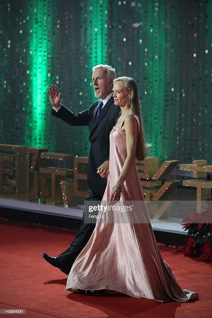 Canadian film director <a gi-track='captionPersonalityLinkClicked' href=/galleries/search?phrase=James+Cameron&family=editorial&specificpeople=206399 ng-click='$event.stopPropagation()'>James Cameron</a> (Left) and his wife <a gi-track='captionPersonalityLinkClicked' href=/galleries/search?phrase=Suzy+Amis&family=editorial&specificpeople=790397 ng-click='$event.stopPropagation()'>Suzy Amis</a> arrive for the red carpet of 2nd Beijing International Film Festival at China National Convention Center on April 23, 2012 in Beijing, China.